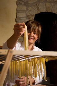 Chef Laura drying pasta click here for more info about the chef's of Tuscookany