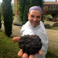 Tuscookany chef Franco with a big Truffle from Torre del Tartufo