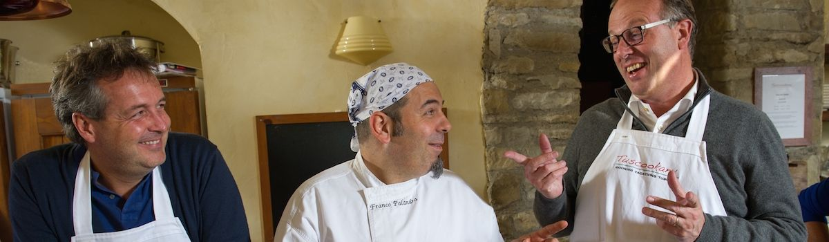 Tuscookany chef Franco with students at the cooking classes in Italy