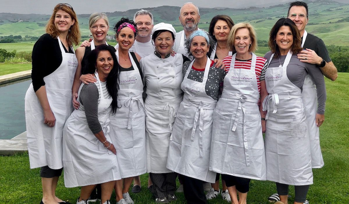 Tuscookany chef Laura with students at Bellorcia cooking school in Tuscany