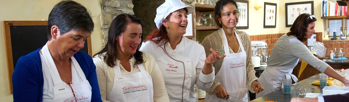 Tuscookany chef Paola with cooking class in Tuscany students