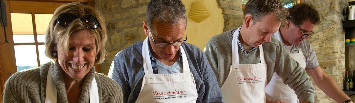 Tuscookany cooking students at the Torre del Tartufo cooking school in Italy